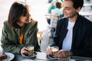 couple on date drinking coffee
