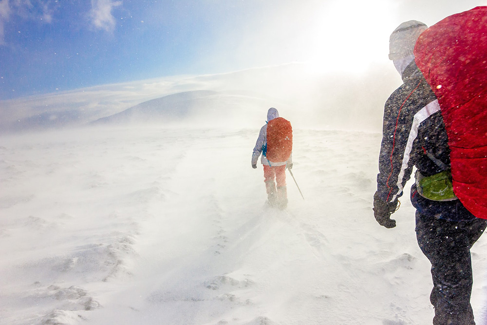 two men backpacking in heavy snow