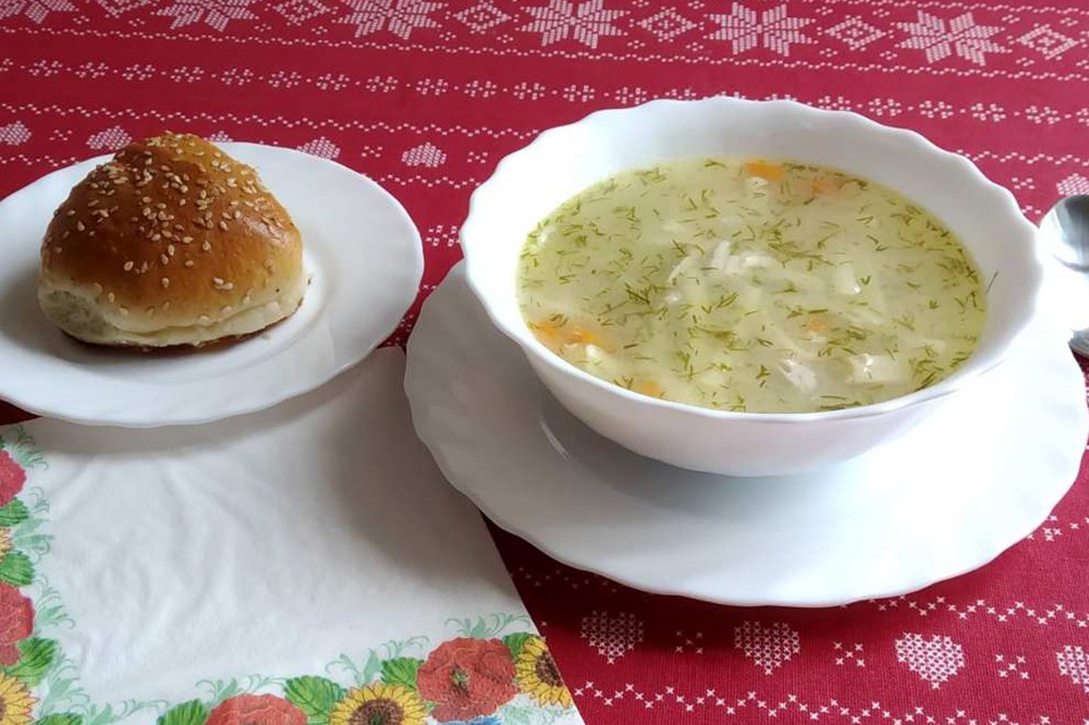 bowl of soup and a roll